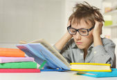 Young boy doing homework — Stok fotoğraf