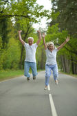 Old couple at forest — Stockfoto