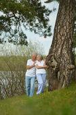 Elderly couple in nature — Stock Photo