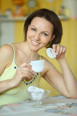 Happy young woman at home — Stockfoto
