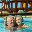 Elderly couple at pool — Stock Photo
