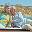Senior couple having boat ride — Stock Photo #47819487