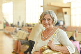 Senior woman in shopping mall — Stock Photo