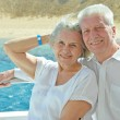 Senior couple having boat ride — Stock Photo #47820249