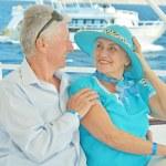 Senior couple having boat ride — Stock Photo #47820587