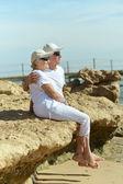 Elderly couple on  beach — Stock Photo