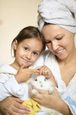 Woman with daughter and rabbit — Stock Photo