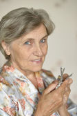 Old woman with pills — Stock Photo
