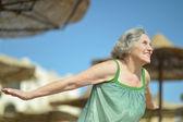 Senior woman on beach — Stock Photo