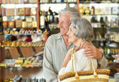 Senior couple at shopping mall — Stock Photo