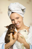 Woman with dog and rabbit — Stock Photo
