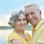Senior couple at lake — Stock Photo #48204347