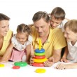 Family playing on floor — Stock Photo #48205345