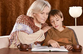 Grandmother and boy read — Stock Photo