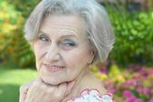 Older woman in summer — Stock Photo