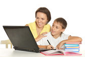 Mother helping her son — Stock Photo