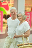 Elderly couple in shopping mall — Foto de Stock