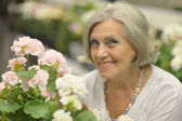 Elderly woman in garden — Stock Photo