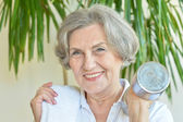 Elderly woman with dumbbell — Stock Photo