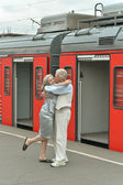 Couple at train station — Stock Photo