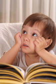 Little caucasian girl with book — Stock Photo