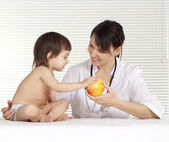 Beautiful doctor with little girl — Stock Photo