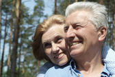 Happy senior couple on nature — Stock Photo