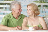 Happy older couple drink coffee — Stock Photo