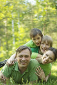 Family resting in summer park — Stock Photo