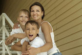 Smiling happy mother and sons — Stock Photo