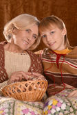 Senior woman knitting with grandson — Stock Photo