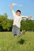 Cute little boy jumping — Stock Photo