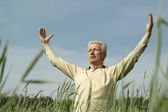Mature man enjoying on nature — Stock Photo