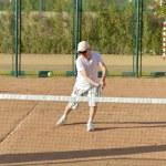 Active senior man playing tennis — Stock Photo #49995121