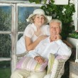 Elderly couple on wooden porch — Stock Photo #49995551