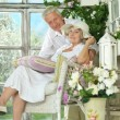 Elderly couple on wooden porch — Stock Photo #49996075