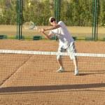 Active senior man playing tennis — Stock Photo #49996239