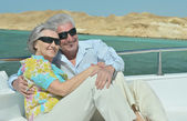 Elderly couple have a ride in a boat — Stock Photo