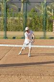 Active senior man playing tennis — Stock Photo