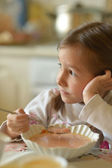 Girl eating soup — Stock Photo
