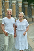 Mature couple walking in town — Stock Photo