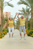 Married couple exercising on fresh air — Stock Photo
