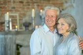 Elderly couple in vintage interior — Stock Photo