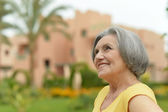 Senior woman on a walk in tropic resort — Stock Photo