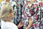 Senior woman at  store — Stock Photo