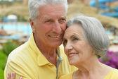 Senior couple by pool — Stock Photo