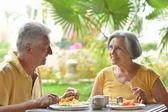 Senior couple eat outside at the resort — Stock Photo