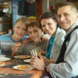 Cute family eating pizza — Stock Photo