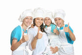 Chef with assistants showing thumbs up — Stock Photo