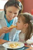 Mother feeding daughter — Stock Photo